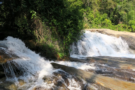 big river ending in a nice Waterfall, Thailand Stock Photo
