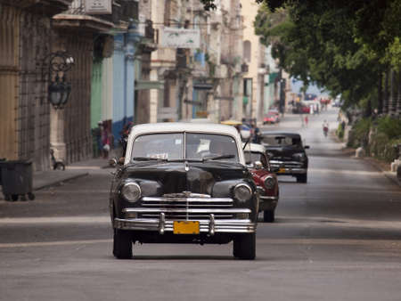 oldtimer: Old American car in transit on the Paseo del Prado in Havana