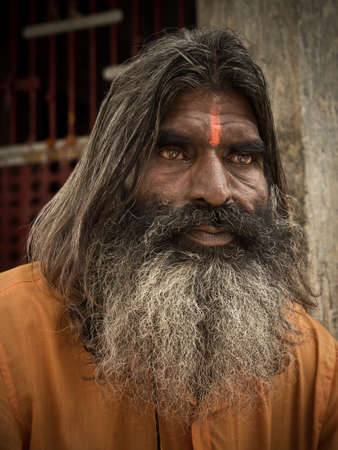 Pushkar, Rajasthan, India - 20 August 2012: Portrait of sadhu monk, solely dedicated to achieving the fourth and final Hindu goal of life, moksha (liberation). Stock Photo - 15394820