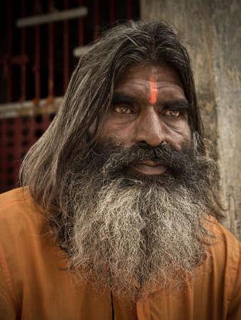 moksha: Pushkar, Rajasthan, India - 20 August 2012: Portrait of sadhu monk, solely dedicated to achieving the fourth and final Hindu goal of life, moksha (liberation).