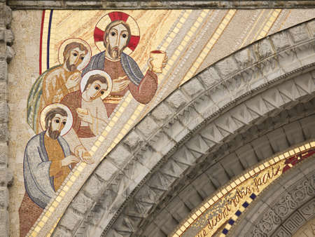 faiths: detail of the mosaic on the façade of the Rosary Basilica in Lourdes Editorial