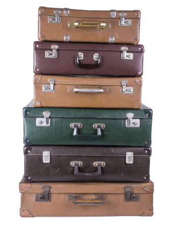 goodie: a stack of older assorted luggage pieces isolated on white Stock Photo