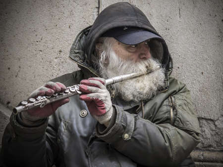 New Yor City, USA - April 1, 201: A street flute player at the Wall Street