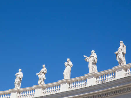 st  peter: Statues facing St. Peter basilique in Rome, Italy.