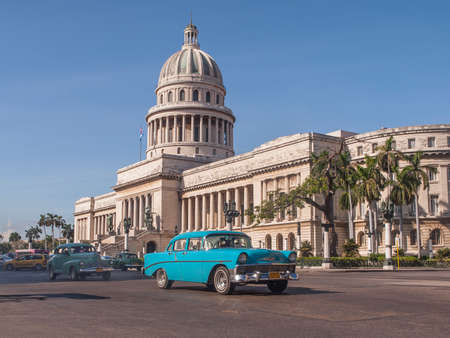 capitolio: old American cars passing in front of the Capitolio in Havana, Cuba Stock Photo