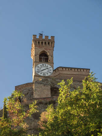 crenellated tower: Medieval crenellated brick wall Clock tower in Brisighella, Emilia Romagna in Italy