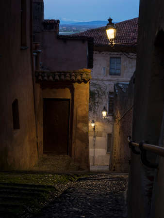 saluzzo: Typical steps in Saluzzo in the old city at sunset Stock Photo