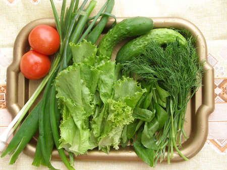 spinage: Verdure and vegetables on the tray. Vitamins are in summer useful for the health.
