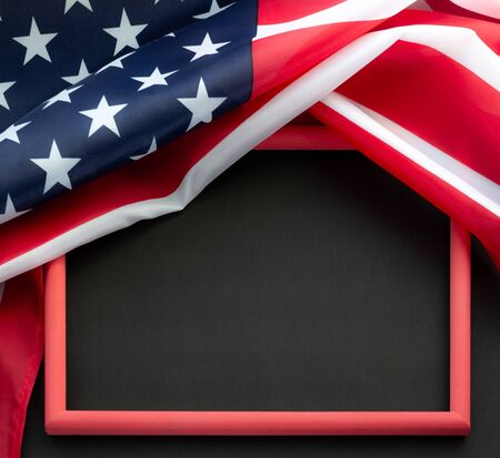 Flag of USA on black background with copy space in red frame. Concept of the patriotic holidays.
