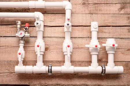 Heating and water system in a private house using white plastic pipes.