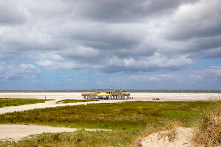 Beach pavilion on the beach of Schiermonnikoog on the North Sea side seen from the dunes