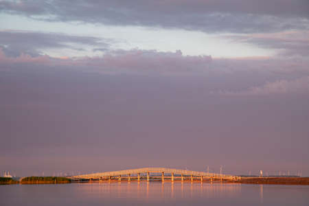 Bridge on the Markerwadden at sunset. The Marker Wadden, artificial archipelago in development located in the Markermeer, Holland.