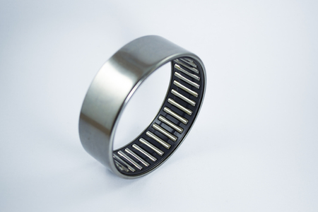 silver ring: Bearing cage with silver cover on white background Stock Photo