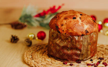 Panetone surrounded with Christmas ornaments