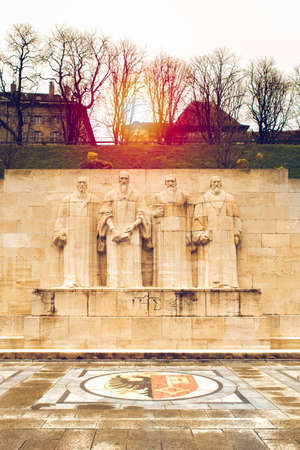 Reformation wall in Parc des Bastions in Geneva, Switzerland depicted at sunset. Sculptures figuring John Calvin, John Knox, William Farel, Theodore Beza Sajtókép