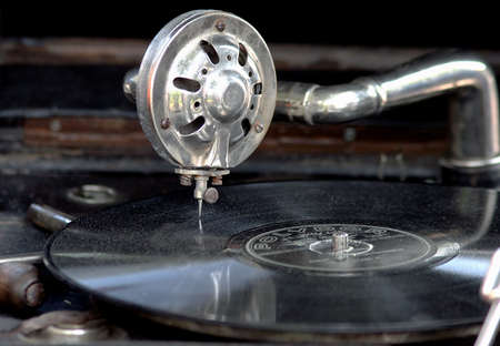 Vintage gramophone with old vinyl disk