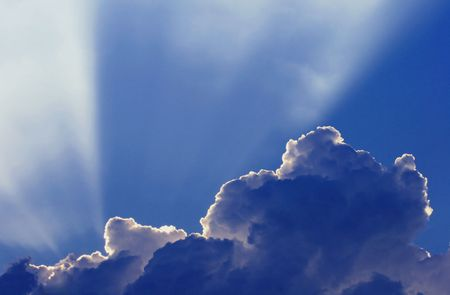 Rays of light from behind a cloud Stock Photo
