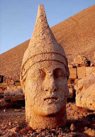 monumental: Monumental head of Apollo at sunset, Namrut Dagi, Turkey