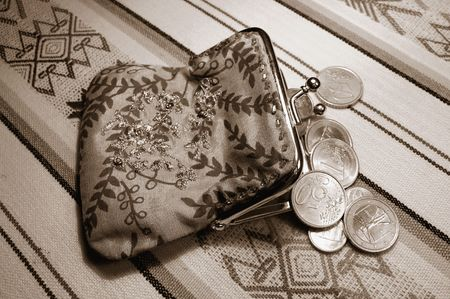 change purses: Coins and change purse  Stock Photo