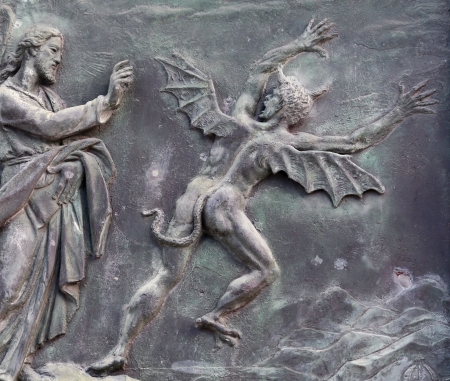 devilish: Christ and the devil - ancient bas relief, Pisa, Italy Stock Photo