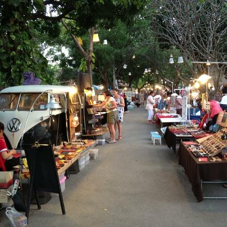 artwork: An outdoor flea market with a lots of creative handmade work.
