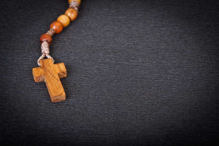 Close up of Christian Wooden Cross on black background