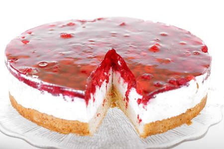 Raspberry layer cake serves on glass plate photo