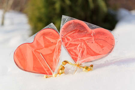 Two sweet red candy Valentines shape heart on ice pack in foil bag photo