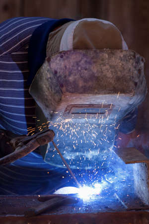 Factory welder working, visible sparkle and smoke   Stock Photo - 13109732