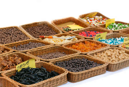 Varieties of sweets nuts peanuts, hazelnuts, chestnuts, walnuts, pistachio and pecans photo
