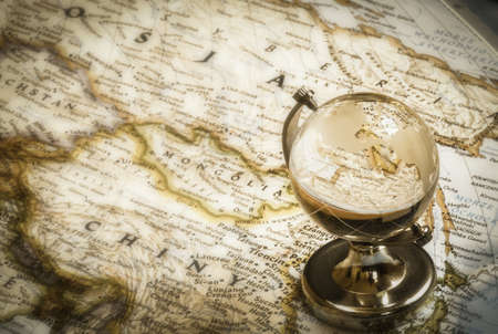 old globe glass and vintage map as travel concept  Stock Photo
