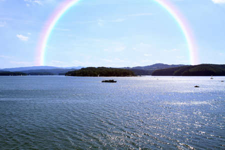 beautiful landscape with rainbow over Solina Lake water, Bieszczady Park
