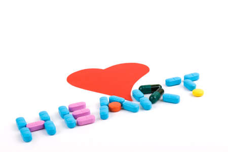 heart shape and colorful pills, medical concept on white background Stock Photo - 15398836