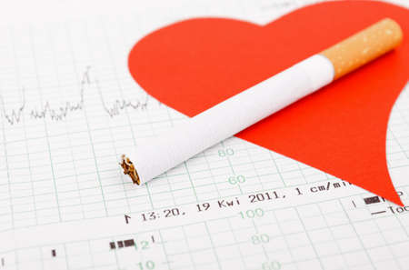 red heart shape with cigarette on cardiogram  Stock Photo