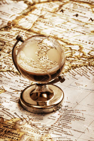 old globe glass and vintage map, education concept  photo