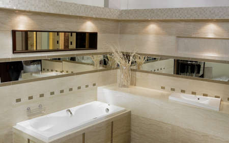 Stylish modern bathroom with bath shower, sink and toilet photo