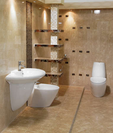 Stylish modern bathroom with basin, sink and toilet photo