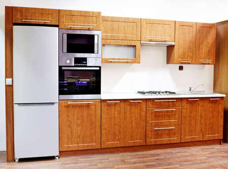 armario cocina: Modernos dise�os de la cocina en casa interior Foto de archivo