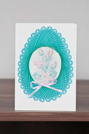 Easter eggs card handmade concept on wooden background  photo