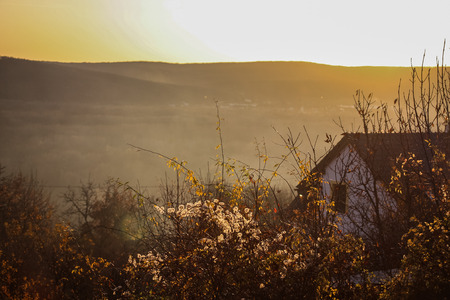 horisontal: House with hazy hills in the background