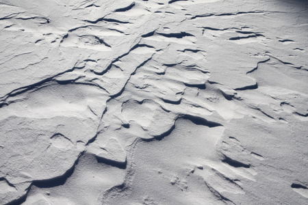 uneven: Texture of uneven snow dunes Stock Photo