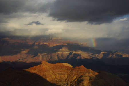 Rainbow, storm cloud and sun on Grand Canyon, Arizona photo