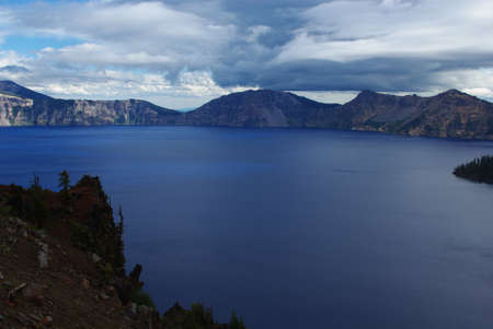 crater lake: Deep blue Crater Lake and cloud