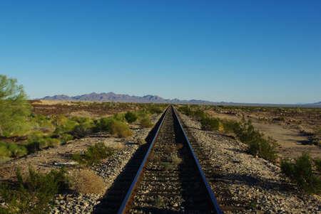 emptiness: Railway Track  through vastness and emptiness of California Desert