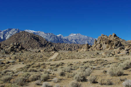 Bizarre rock formation, Alabama Hills and Sierra Nevada, California photo