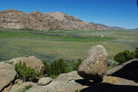 Boulder, rocks and green river valley, Split Rock, Wyoming Stock Photo - 12733675