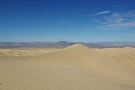 Vast Mojave Desert dunes and mountain chains, California