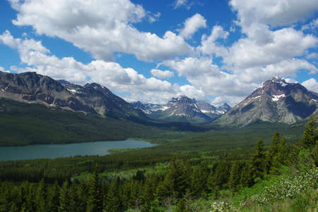 Lake, forest and massive mountains, Glacier National Park, Montana photo