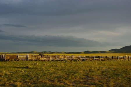 Corral, prairie and green hills near Dillon, Montana
