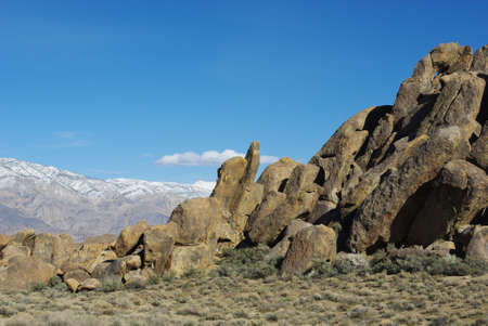 Alabama Hills rock formations and snowy mountains, California Stock Photo - 12733424
